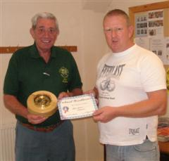 Bert Lanham receives a certificate from Tony